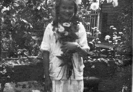 Catherine Brantley as a girl with flowers
